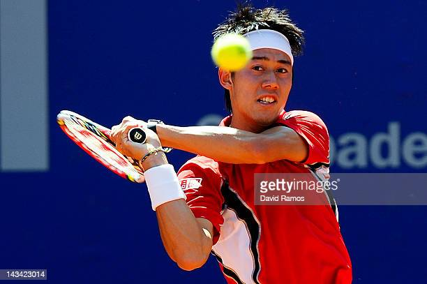 Kei Nishikori of Japan returns the ball against Albert Ramos during their match on day 4 of the ATP 500 World Tour Barcelona Open Banco Sabadell 2012...