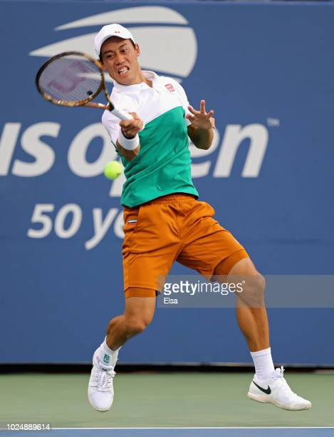Kei Nishikori of Japan returns the ball during his men's singles first round match against Maximilian Marterer of Germany on Day Two of the 2018 US...
