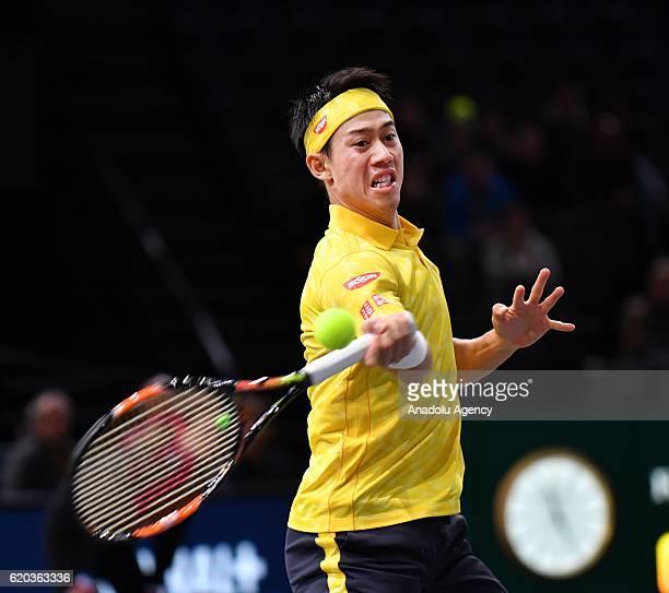 Kei Nishikori of Japan returns the ball during his men's singles match against Viktor Troicki of Serbia at BNP Paribas Paris Masters 2016 in Paris...