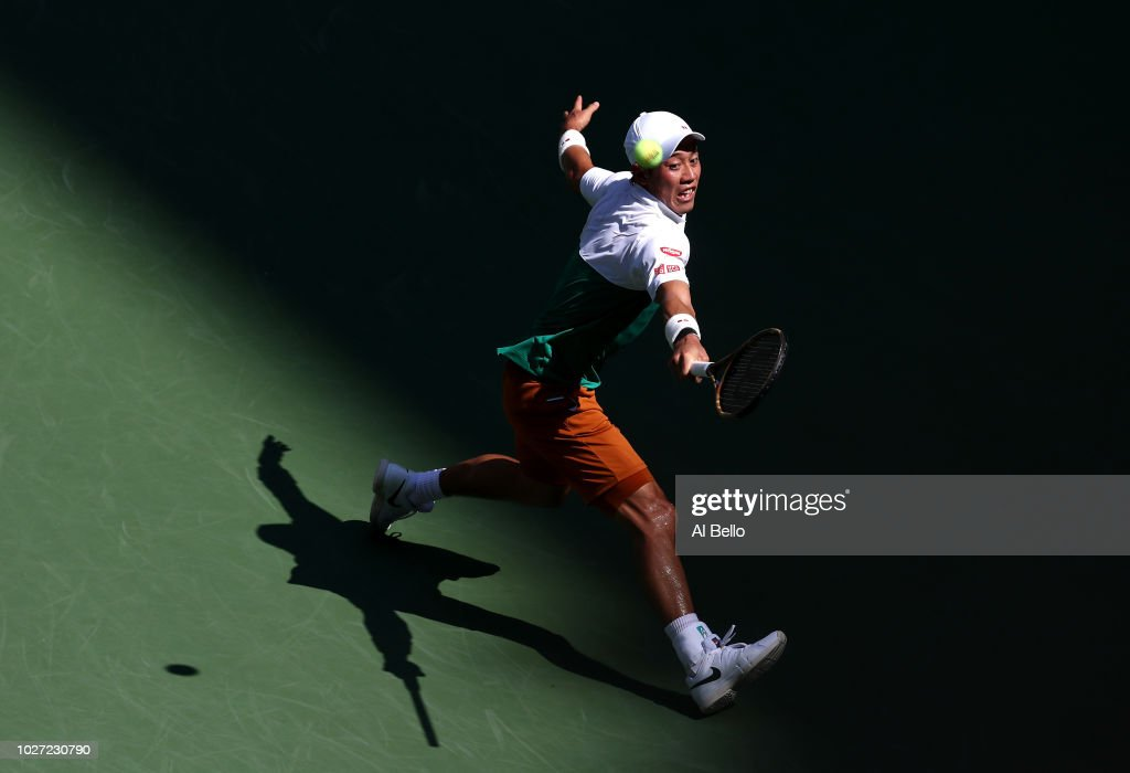 Kei Nishikori of Japan returns the ball during his men's singles quarter-final match against Marin Cilic of Croatia on Day Ten of the 2018 US Open at the USTA Billie Jean King National Tennis Center on September 5, 2018 in the Flushing neighborhood of the Queens borough of New York City.