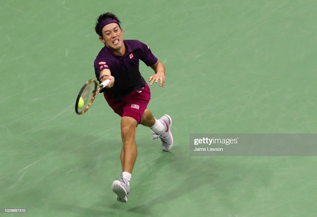 Kei Nishikori of Japan returns the ball during his men's singles semi-final match against Novak Djokovic of Serbia on Day Twelve of the 2018 US Open at the USTA Billie Jean King National Tennis Center on September 7, 2018 in the Flushing neighborhood of the Queens borough of New York City.