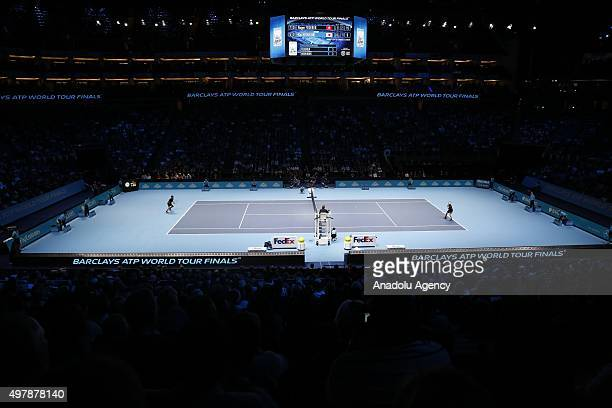 Kei Nishikori of Japan returns the ball to Roger Federer of Switzerland during their men's singles match at the ATP World Tour Finals tennis...