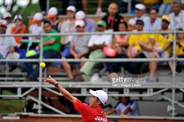 Kei Nishikori of Japan serves a ball during the Davis Cup World Group Playoff singles match between Alejandro Falla of Colombia and Kei Nishikori of...
