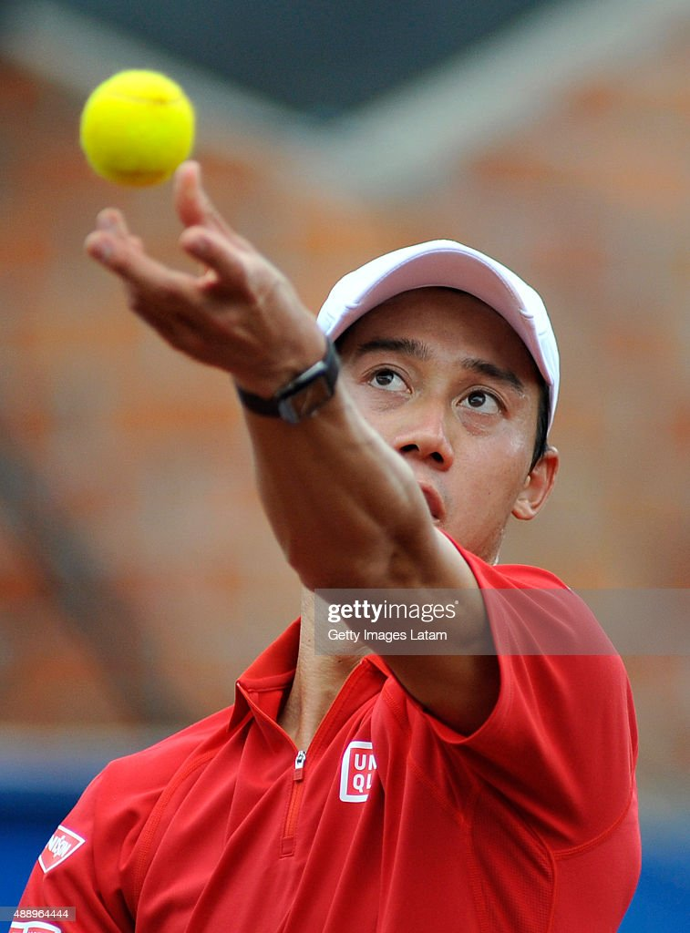 Kei Nishikori of Japan serves a ball during the Davis Cup World Group Play-off singles match between Alejandro Falla of Colombia and Kei Nishikori of Japan at Club Campestre on September 18, 2015 in Pereira, Colombia.