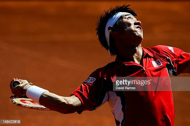 Kei Nishikori of Japan serves against Albert Ramos during their match on day 4 of the ATP 500 World Tour Barcelona Open Banco Sabadell 2012 tennis...
