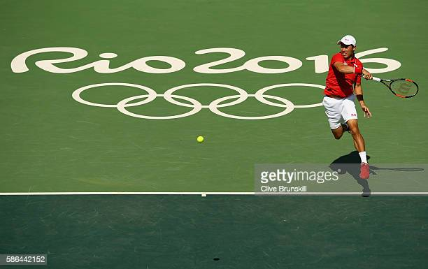 Kei Nishikori of Japan serves against Albert RamosVinolas of Spain in their first round match on Day 1 of the Rio 2016 Olympic Games at the Olympic...
