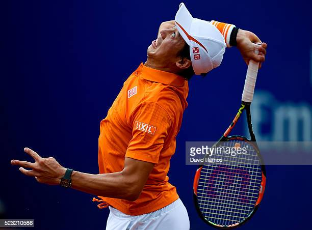 Kei Nishikori of Japan serves against Alexandr Dolgopolov of Ukraine during day five of the Barcelona Open Banc Sabadell at the Real Club de Tenis...