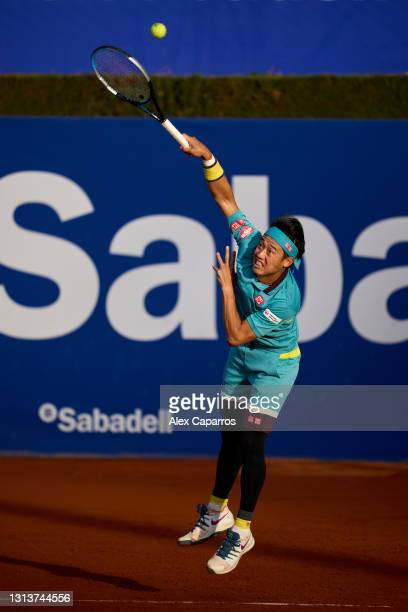 Kei Nishikori of Japan serves against Cristian Garin of Chile in their second round match during day three of the Barcelona Open Banc Sabadell 2021...
