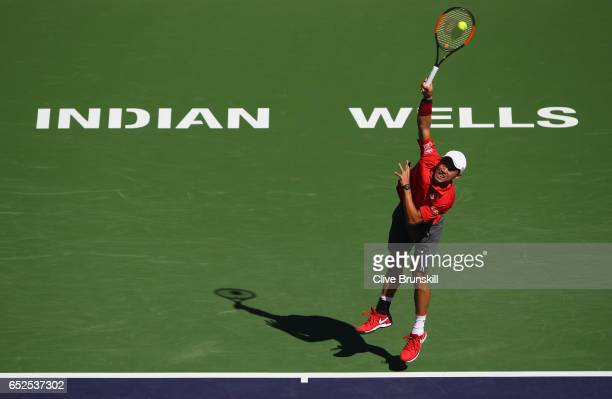 Kei Nishikori of Japan serves against Dan Evans of Great Britain in their second round match during day seven of the BNP Paribas Open at Indian Wells...