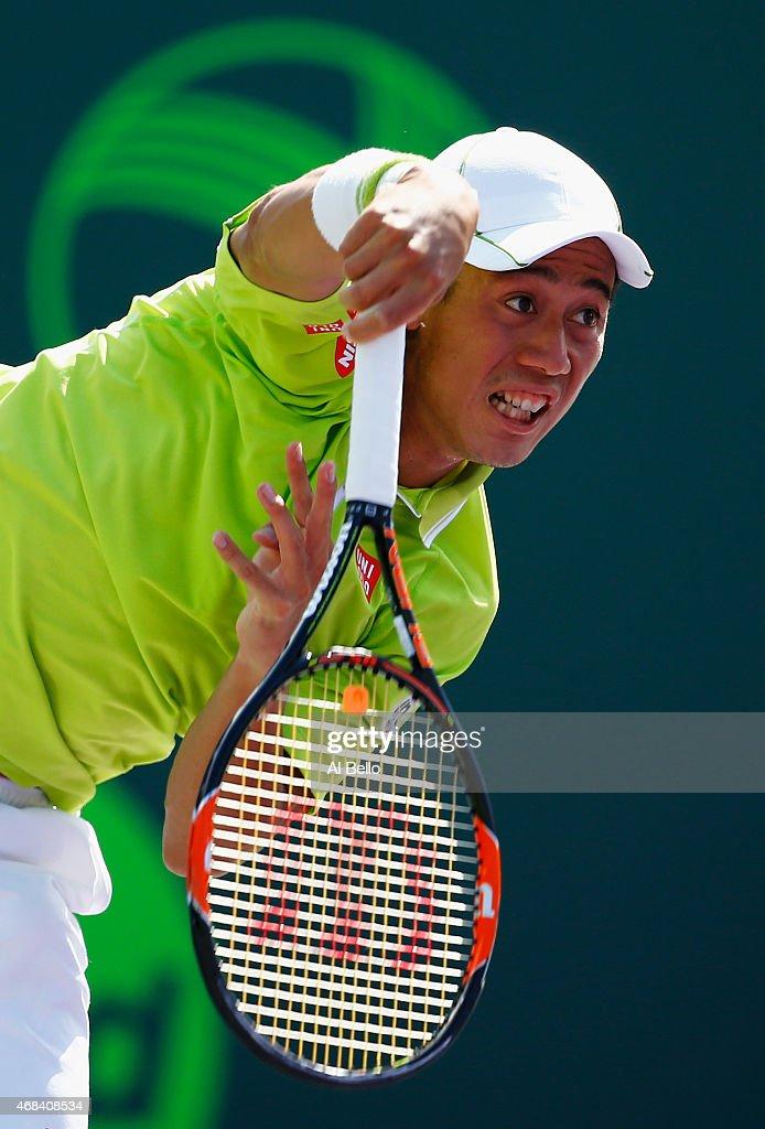 Kei Nishikori of Japan serves against John Isner during day 11 of the Miami Open at Crandon Park Tennis Center on April 2, 2015 in Key Biscayne, Florida.