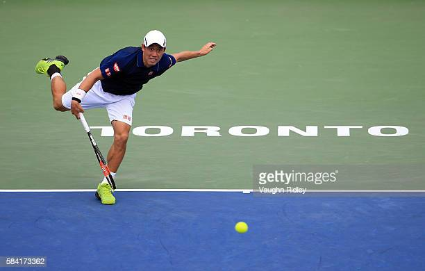 Kei Nishikori of Japan serves against Rajeev Ram of the USA during Day 4 of the Rogers Cup at the Aviva Centre on July 28 2016 in Toronto Ontario...