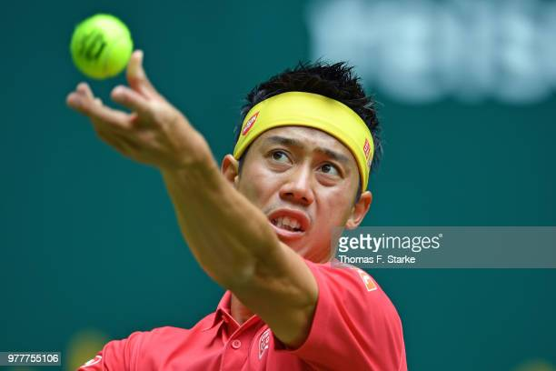 Kei Nishikori of Japan serves during his match against Matthias Bachinger of Germany during day 1 of the Gerry Weber Open at Gerry Weber Stadium on...