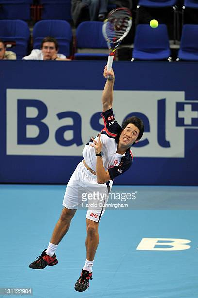 Kei Nishikori of Japan serves during his match against Tomas Berdych of Czech Republic during day two of the Swiss Indoors at St Jakobshalle on...