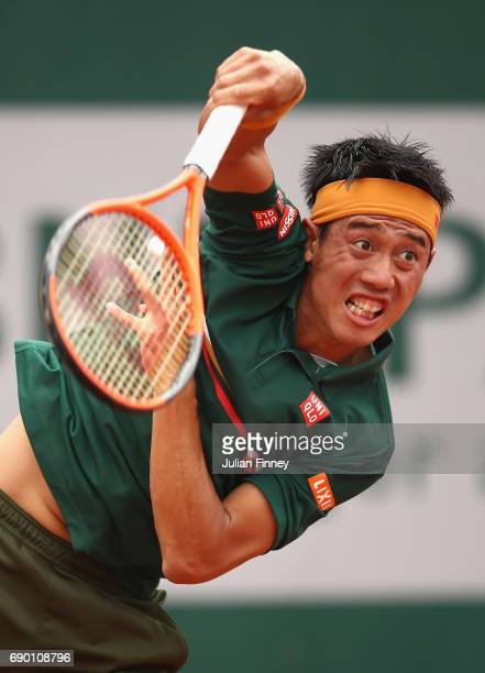 Kei Nishikori of Japan serves during the mens singles first round match against Thanasi Kokkinakis of Australia on day three of the 2017 French Open...