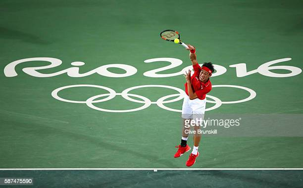 Kei Nishikori of Japan serves during the Men's Singles second round match against John Millman of Australia on Day 3 of the Rio 2016 Olympic Games at...