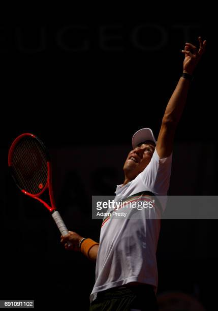 Kei Nishikori of Japan serves during the men's singles second round match against Jeremy Chardy of France on day five of the 2017 French Open at...