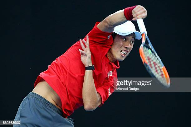 Kei Nishikori of Japan serves in his fourth round match against Roger Federer of Switzerland on day seven of the 2017 Australian Open at Melbourne...
