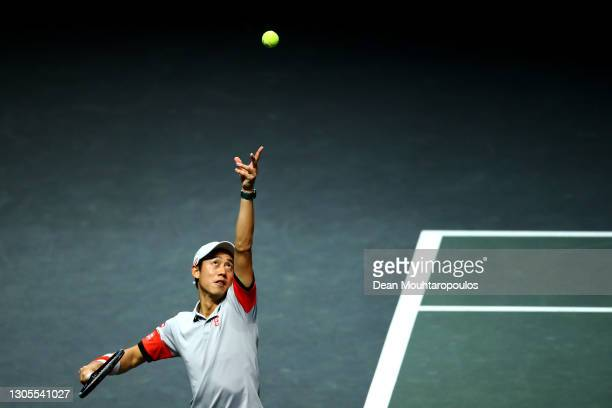 Kei Nishikori of Japan serves in his match against Borna Coric of Croatia during Day 5 of the 48th ABN AMRO World Tennis Tournament at Ahoy on March...