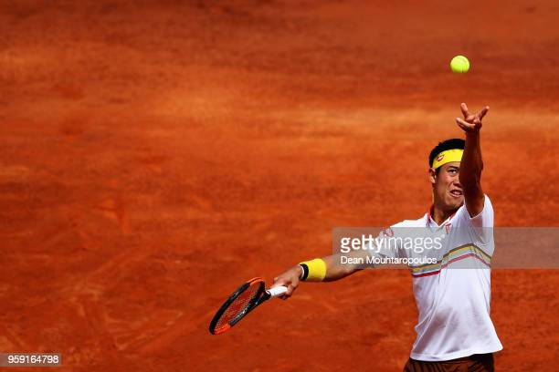 Kei Nishikori of Japan serves in his match against Grigor Dimitrov of Bulgaria during day 4 of the Internazionali BNL d'Italia 2018 tennis at Foro...