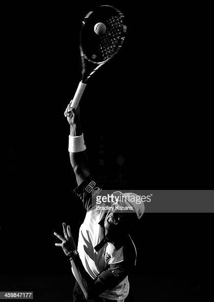 Kei Nishikori of Japan serves in his match against Matthew Ebden of Australia during day four of the 2014 Brisbane International at Queensland Tennis...
