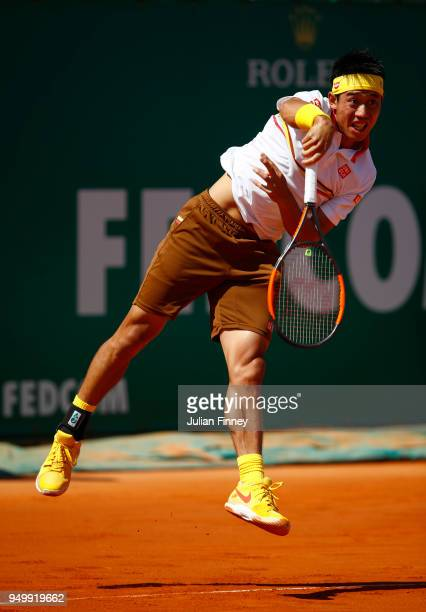 Kei Nishikori of Japan serves in his match against Rafael Nadal of Spain during day eight of ATP Masters Series Monte Carlo Rolex Masters at...