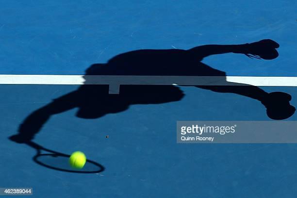 Kei Nishikori of Japan serves in his quarterfinal match against Stanislas Wawrinka of Switzerland during day 10 of the 2015 Australian Open at...