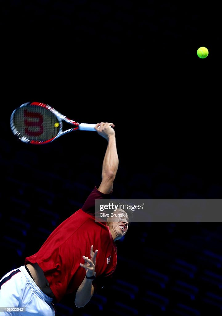 Kei Nishikori of Japan serves in practice during the Barclays ATP World Tour Finals tennis previews at the O2 Arena on November 8, 2014 in London, England.