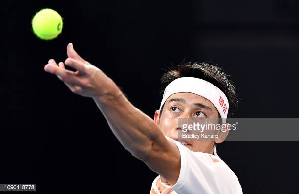 Kei Nishikori of Japan serves in the Men's Finals match against Daniil Medvedev of Russia during day eight of the 2019 Brisbane International at Pat...