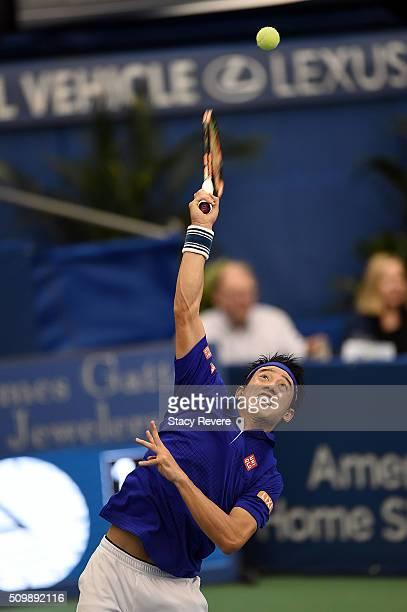 Kei Nishikori of Japan serves to Mikhail Kukushkin of Kazakhstan during their quarterfinal singles match on Day 5 of the Memphis Open at the Racquet...