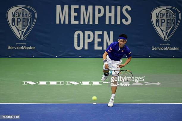 Kei Nishikori of Japan serves to Mikhail Kukushkin of Kazakhstan during their quarterfinal singles match on Day 5 of the Memphis Open at the Racquet...
