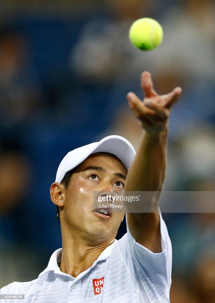 Kei Nishikori of Japan serves to Milos Raonic of Canada on Day Eight of the 2014 US Open at the USTA Billie Jean King National Tennis Center on September 1, 2014 in the Flushing neighborhood of the Queens borough of New York City.