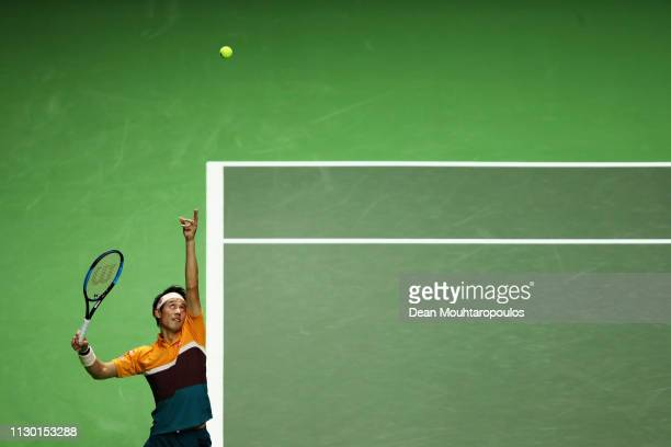 Kei Nishikori of Japan serves to Stan Wawrinka of Switzerland in their semi final match during Day 6 of the ABN AMRO World Tennis Tournament at...