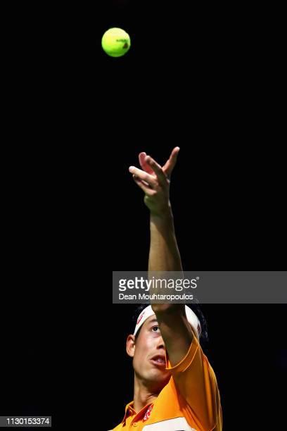 Kei Nishikori of Japan serves to Stan Wawrinka of Switzerland in their semi final match during Day 6 of the ABN AMRO World Tennis Tournament at...