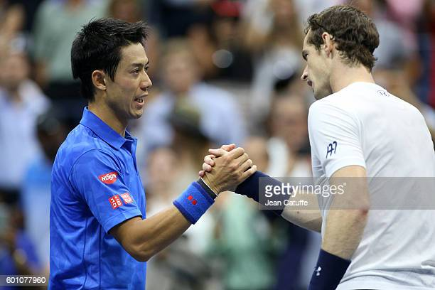 Kei Nishikori of Japan shakes hands with Andy Murray of Great Britain after his victory on day 10 of the 2016 US Open at USTA Billie Jean King...