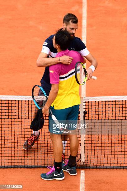 Kei Nishikori of Japan shakes hands with Benoit Paire of France following their mens singles fourth round match during Day nine of the 2019 French...