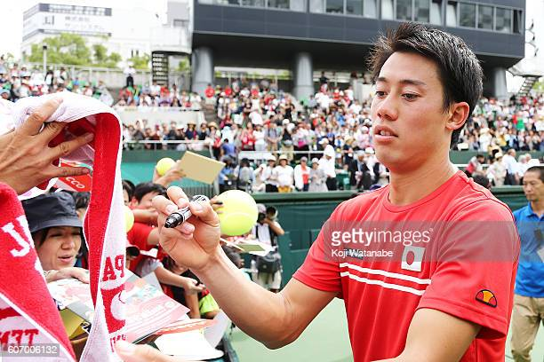 Kei Nishikori of Japan signs autographs during the Davis Cup World Group Playoff doubles match between at Utsubo Tennis Center on September 17 2016...
