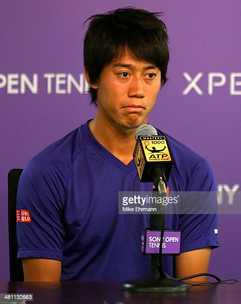Kei Nishikori of Japan speaks at a press conference after withdrawing due to injury prior to his SemiFinal match against Novak Djokovic of Serbia on...