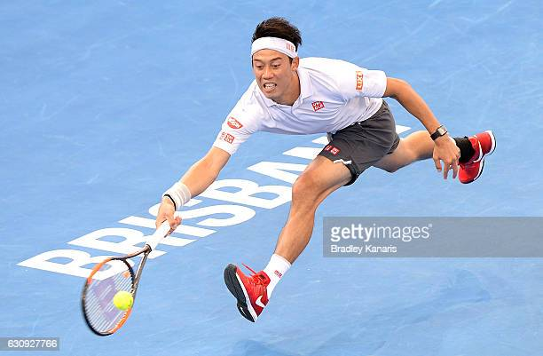 Kei Nishikori of Japan stretches out to play a forehand against Jared Donaldson of the USA on day four of the 2017 Brisbane International at Pat...