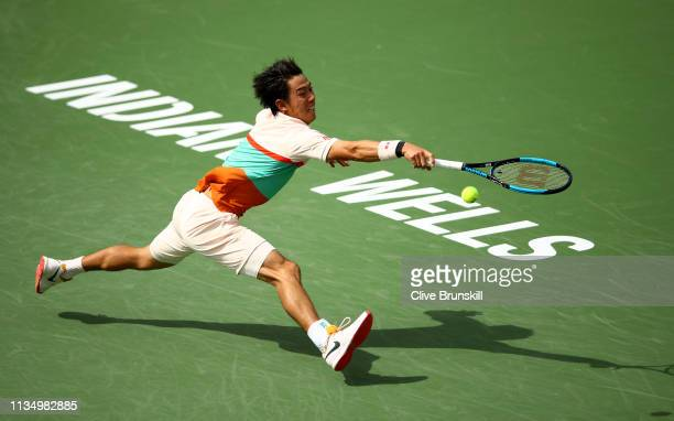 Kei Nishikori of Japan stretches to play a backhand against Adrian Mannarino of France during their men's singles second round match on day seven of...