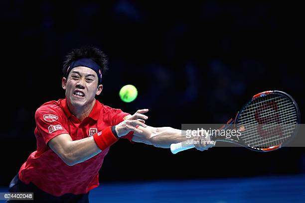Kei Nishikori of Japan stretches to play a forehand shot during his men's singles semi final against Novak Djokovic of Serbia on day seven of the ATP...