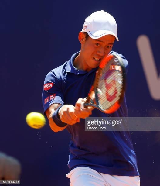 Kei Nishikori of Japan takes a backhand shot during a final match between Kei Nishikori of Japan and Alexandr Dolgopolov of Ukraine as part of ATP...