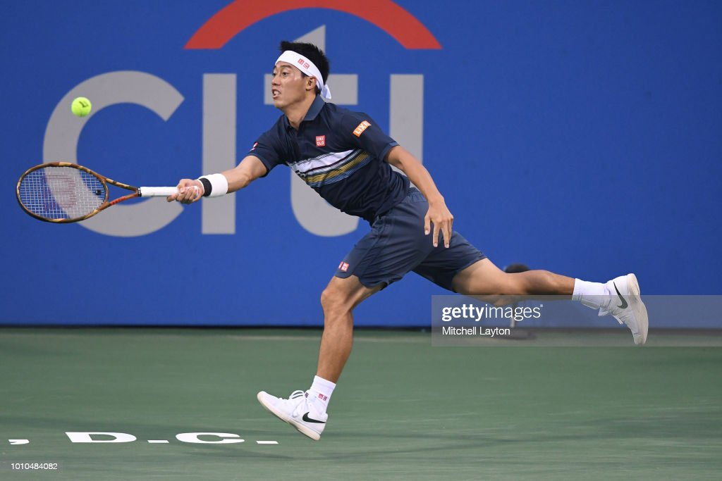 Kei Nishikori of Japan try to return a ball hit by Alexander Zverev of Germany during Day Seven of the Citi Open at the Rock Creek Tennis Center on August 3, 2018 in Washington, DC.