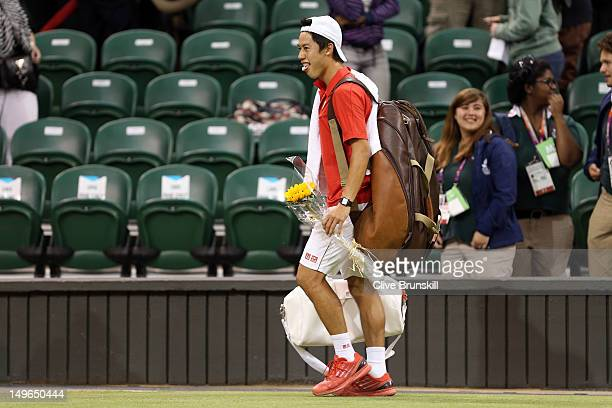Kei Nishikori of Japan walks off court after winning his third round Men's Singles Tennis match against David Ferrer of Spain on Day 5 of the London...