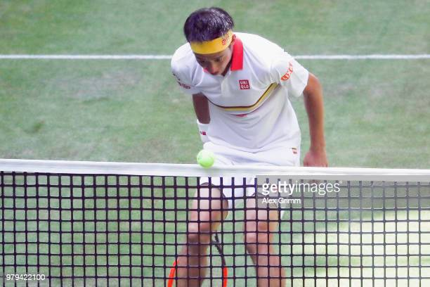 Kei Nishikori of Japan watches his stop ball fly over the net during his round of 16 match against Karen Khachanov of Russia on day 3 of the Gerry...