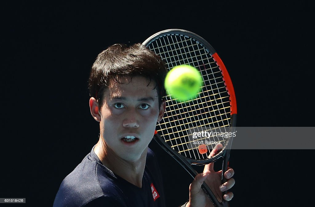 Kei Nishikori of Japan watches the ball during a practice session ahead of the 2017 Australian Open at Melbourne Park on January 12, 2017 in Melbourne, Australia.
