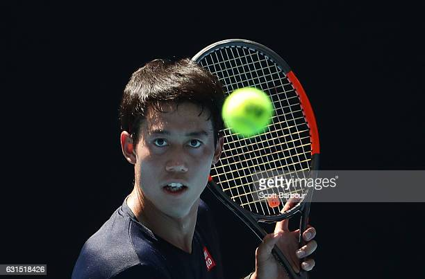 Kei Nishikori of Japan watches the ball during a practice session ahead of the 2017 Australian Open at Melbourne Park on January 12 2017 in Melbourne...