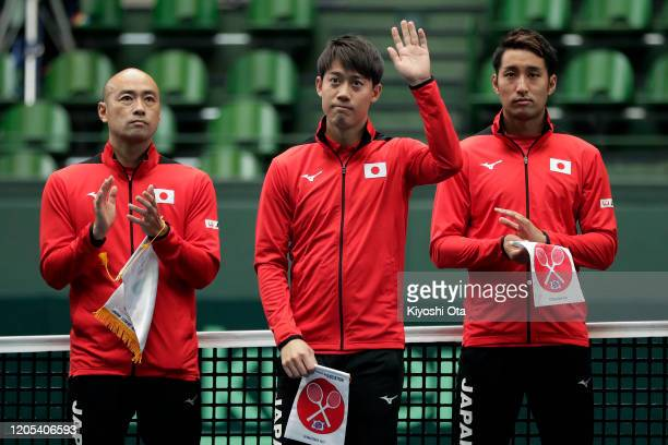 Kei Nishikori of Japan waves as he is introduced during the opening ceremony on day one of the Davis Cup qualifier between Japan and Ecuador at the...
