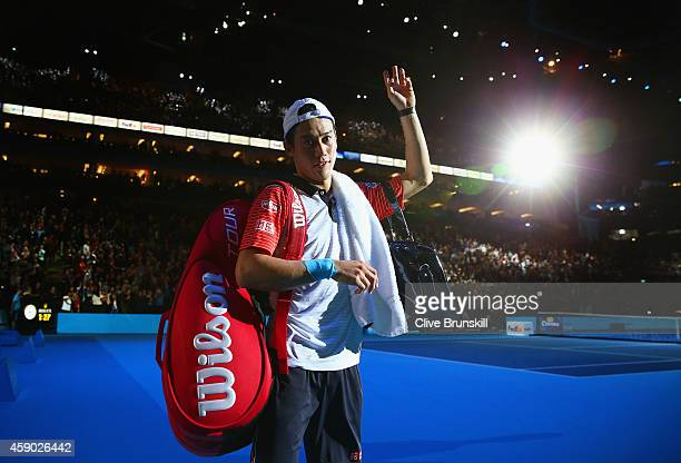 Kei Nishikori of Japan waves to the crowd after defeat in the singles semifinal match against Novak Djokovic of Serbia on day seven of the Barclays...