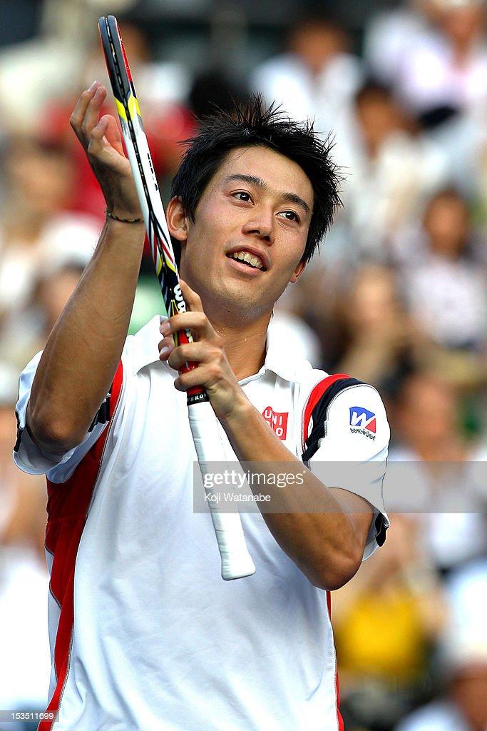 Kei Nishikori of Japan winning a shot against Marcos Baghdatis of Cyprus during day six of the Rakuten Open at Ariake Colosseum on October 6, 2012 in Tokyo, Japan.