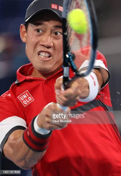 Kei Nishikori of Team Japan plays a backhand during his Men's Singles Quarterfinal match against Novak Djokovic of Team Serbia on day six of the...